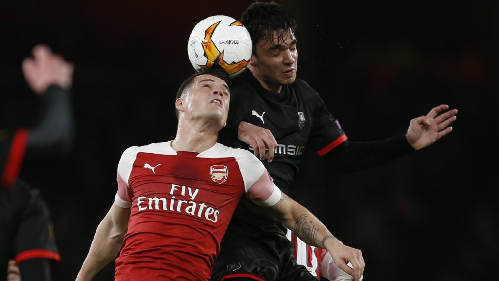 Arsenal's Swiss midfielder Granit Xhaka (L) vies with Rennes' French midfielder Clement Grenier during the UEFA Europa League Round of 16 second leg football match between Arsenal and Rennes at the Emirates Stadium in London on March 14, 2019. (Photo by Ian KINGTON / AFP)