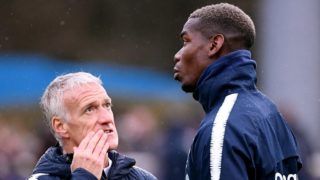France's midfielder Paul Pogba (R) speaks with head coach Didier Deschamps during  a training session in Clairefontaine-en-Yvelines, southwest of Paris, on March 18, 2019, as part of the team's preparation for the upcoming UEFA Euro 2020 Group H qualifying football matches against Moldova and Iceland. - France plays against Moldova on March 22 and Iceland March 25, 2019. (Photo by FRANCK FIFE / AFP)
