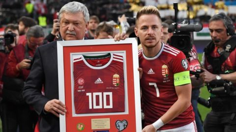 Hungary's midfielder Balazs Dzsudzsak (R) celebrates his 100th match in the national team with the President of the Hungarian Football Association Sandor Csanyi (L) prior to the UEFA Euro 2020 football 1st round Groupe E qualification match between Hungary and Croatia on March 24, 2019 in Budapest. (Photo by ATTILA KISBENEDEK / AFP)