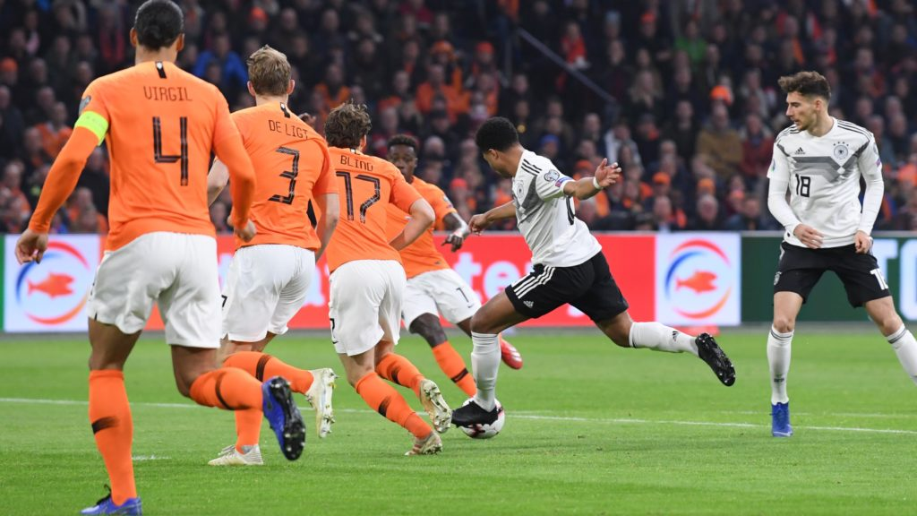 goal, results: Serge Gnabry (Germany) scored the 0: 2 versus Virgil van Dijk (NL), Matthijs de Ligt (NL), Daley Blind (NL). Right: Leon Goretzka (Germany). GES / Football / European Championship qualification: Netherlands- Germany, 24.03.2019 Football / Soccer / Euro-Qualification: The Netherlands vs. Germany, Amsterdam, March 24, 2019 | usage worldwide