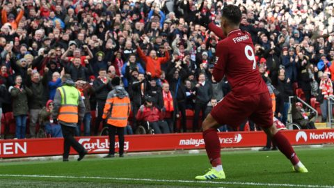 Liverpool's Brazilian midfielder Roberto Firmino celebrates scoring their third goal during the English Premier League football match between Liverpool and Burnley at Anfield in Liverpool, north west England on March 10, 2019. (Photo by Paul ELLIS / AFP) / RESTRICTED TO EDITORIAL USE. No use with unauthorized audio, video, data, fixture lists, club/league logos or 'live' services. Online in-match use limited to 120 images. An additional 40 images may be used in extra time. No video emulation. Social media in-match use limited to 120 images. An additional 40 images may be used in extra time. No use in betting publications, games or single club/league/player publications. /