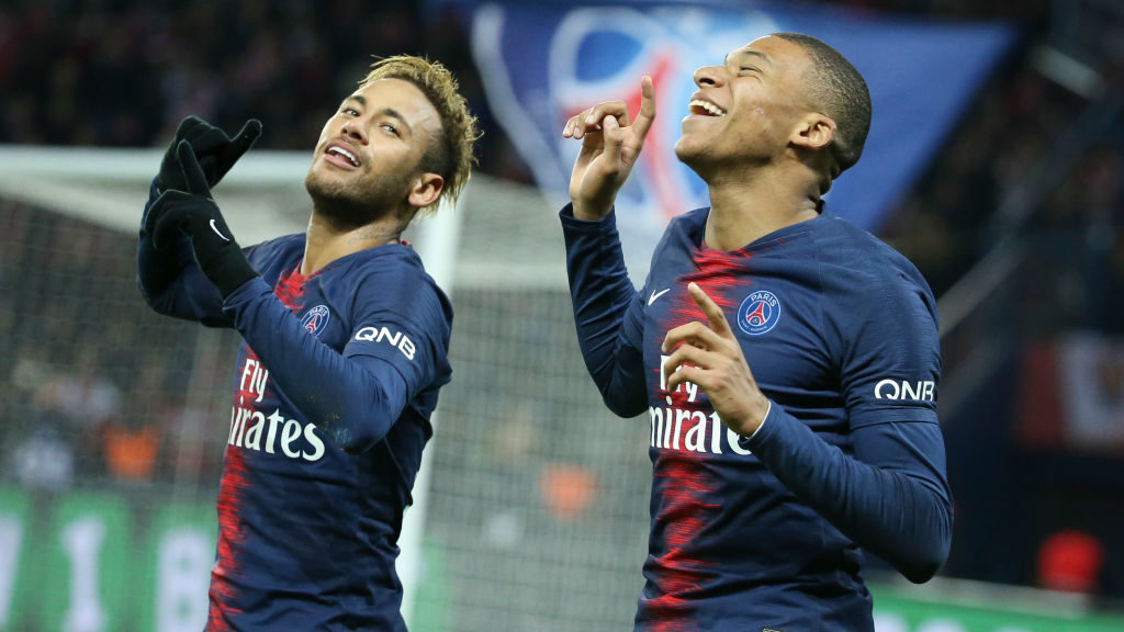 PARIS, FRANCE - NOVEMBER 2: Neymar Jr of PSG celebrates his goal with Kylian Mbappe during the french Ligue 1 match between Paris Saint-Germain (PSG) and Lille OSC (LOSC) at Parc des Princes stadium on November 2, 2018 in Paris, France. (Photo by Jean Catuffe/Getty Images)
