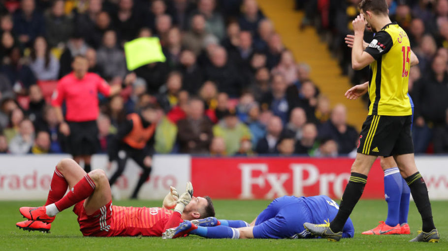 WATFORD, ENGLAND - MARCH 03: Ben Foster of Watford and Jamie Vardy of Leicester City clash  during the Premier League match between Watford FC and Leicester City at Vicarage Road on March 03, 2019 in Watford, United Kingdom. (Photo by Richard Heathcote/Getty Images)