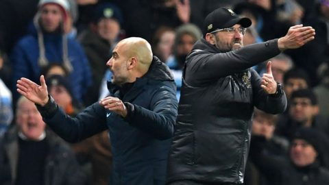 Liverpool's German manager Jurgen Klopp (R) and Manchester City's Spanish manager Pep Guardiola (L) gesture on the touchline during the English Premier League football match between Manchester City and Liverpool at the Etihad Stadium in Manchester, north west England, on January 3, 2019. - Manchester City won the game 2-1. (Photo by Paul ELLIS / AFP) / RESTRICTED TO EDITORIAL USE. No use with unauthorized audio, video, data, fixture lists, club/league logos or 'live' services. Online in-match use limited to 120 images. An additional 40 images may be used in extra time. No video emulation. Social media in-match use limited to 120 images. An additional 40 images may be used in extra time. No use in betting publications, games or single club/league/player publications. /