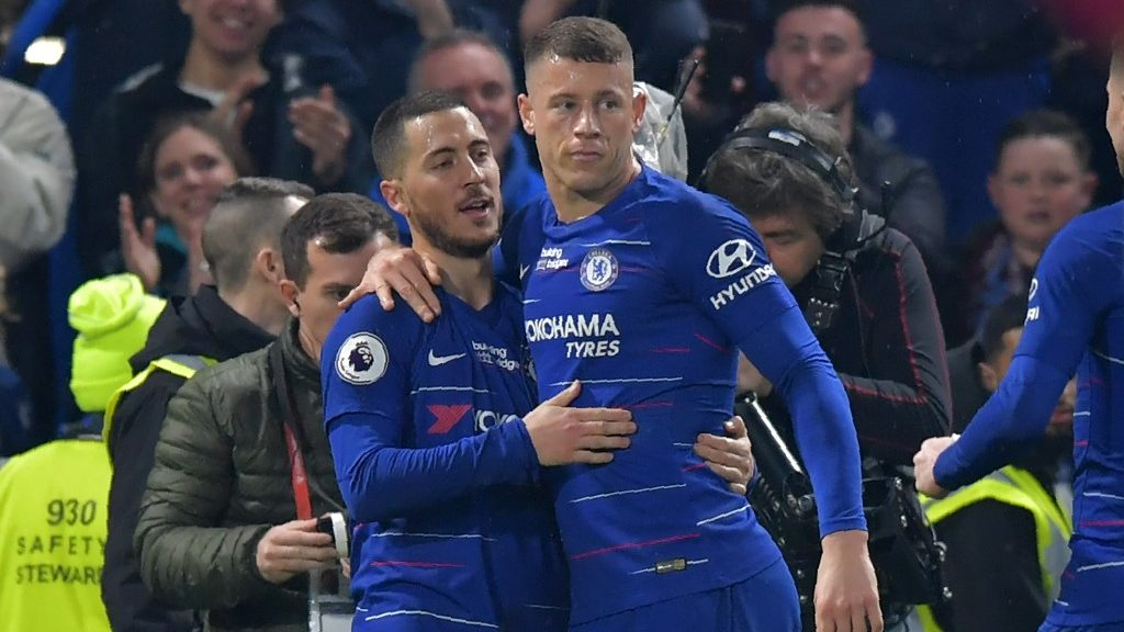 Chelsea's Belgian midfielder Eden Hazard (L) celebrates with Chelsea's English midfielder Ross Barkley (R) after scoring their second goal during the English Premier League football match between Chelsea and West Ham United at Stamford Bridge in London on April 8, 2019. - Hazard scored both goals as Chelsea won the game 2-0. (Photo by OLLY GREENWOOD / AFP) / RESTRICTED TO EDITORIAL USE. No use with unauthorized audio, video, data, fixture lists, club/league logos or 'live' services. Online in-match use limited to 120 images. An additional 40 images may be used in extra time. No video emulation. Social media in-match use limited to 120 images. An additional 40 images may be used in extra time. No use in betting publications, games or single club/league/player publications. /
