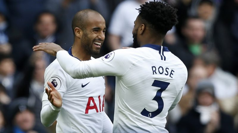 Tottenham Hotspur's Brazilian midfielder Lucas Moura (L) celebrates with Tottenham Hotspur's English defender Danny Rose (R) after scoring their third goal during the English Premier League football match between Tottenham Hotspur and Huddersfield Town at Tottenham Hotspur Stadium in London, on April 13, 2019. (Photo by Ian KINGTON / AFP) / RESTRICTED TO EDITORIAL USE. No use with unauthorized audio, video, data, fixture lists, club/league logos or 'live' services. Online in-match use limited to 120 images. An additional 40 images may be used in extra time. No video emulation. Social media in-match use limited to 120 images. An additional 40 images may be used in extra time. No use in betting publications, games or single club/league/player publications. /