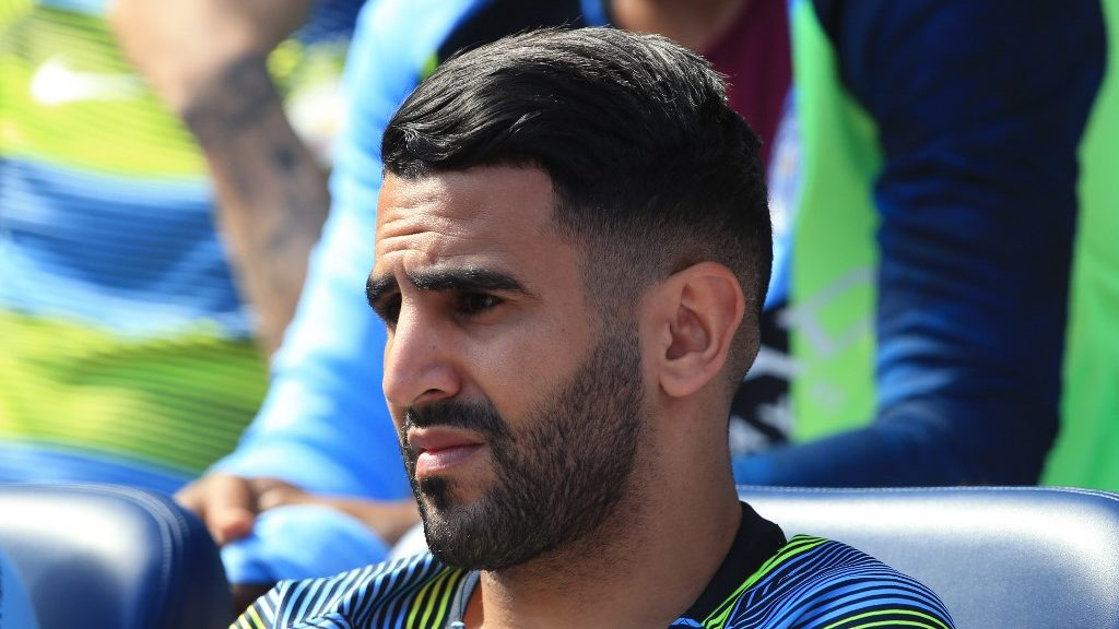Manchester City's Algerian midfielder Riyad Mahrez  looks on from the bench during the English Premier League football match between Manchester City and Tottenham Hotspur at the Etihad Stadium in Manchester, north west England, on April 20, 2019. (Photo by Lindsey PARNABY / AFP) / RESTRICTED TO EDITORIAL USE. No use with unauthorized audio, video, data, fixture lists, club/league logos or 'live' services. Online in-match use limited to 120 images. An additional 40 images may be used in extra time. No video emulation. Social media in-match use limited to 120 images. An additional 40 images may be used in extra time. No use in betting publications, games or single club/league/player publications. /