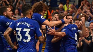Chelsea's Argentinian striker Gonzalo Higuain (2nd R) celebrates with teammates after scoring their second goal during the English Premier League football match between Chelsea and Burnley at Stamford Bridge in London on April 22, 2019. (Photo by Glyn KIRK / AFP) / RESTRICTED TO EDITORIAL USE. No use with unauthorized audio, video, data, fixture lists, club/league logos or 'live' services. Online in-match use limited to 120 images. An additional 40 images may be used in extra time. No video emulation. Social media in-match use limited to 120 images. An additional 40 images may be used in extra time. No use in betting publications, games or single club/league/player publications. /