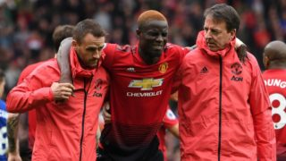 Manchester United's Ivorian defender Eric Bailly (C) goes off with an injury during the English Premier League football match between Manchester United and Chelsea at Old Trafford in Manchester, north west England, on April 28, 2019. (Photo by Paul ELLIS / AFP) / RESTRICTED TO EDITORIAL USE. No use with unauthorized audio, video, data, fixture lists, club/league logos or 'live' services. Online in-match use limited to 120 images. An additional 40 images may be used in extra time. No video emulation. Social media in-match use limited to 120 images. An additional 40 images may be used in extra time. No use in betting publications, games or single club/league/player publications. /