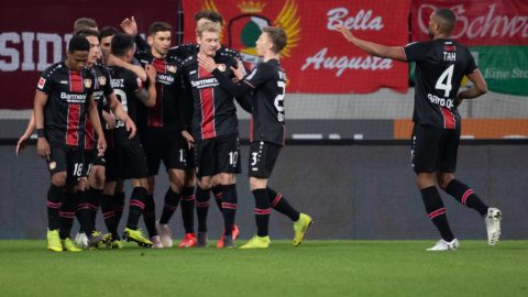 26 April 2019, Bavaria, Augsburg: Soccer: Bundesliga, FC Augsburg - Bayer Leverkusen, 31st matchday in the WWK-Arena. The players of Leverkusen cheer over the goal to 1:1. Photo: Sven Hoppe/dpa - IMPORTANT NOTE: In accordance with the requirements of the DFL Deutsche Fußball Liga or the DFB Deutscher Fußball-Bund, it is prohibited to use or have used photographs taken in the stadium and/or the match in the form of sequence images and/or video-like photo sequences.