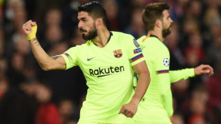 Barcelona's Uruguayan forward Luis Suarez celebrates after scoring during the UEFA Champions league first leg quarter-final football match between Manchester United and Barcelona at Old Trafford in Manchester, north west England, on April 10, 2019. (Photo by Oli SCARFF / AFP)