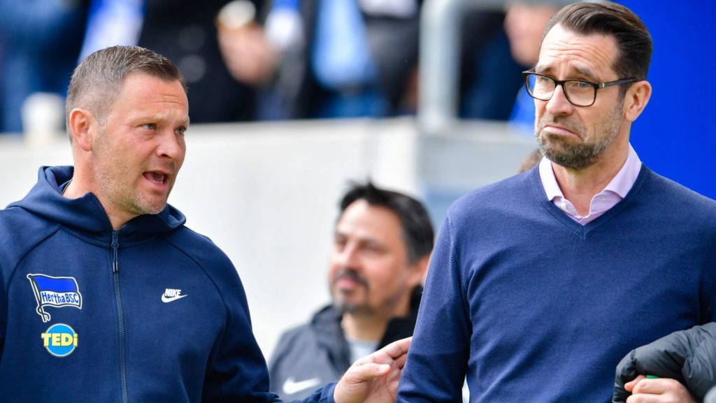 14 April 2019, Baden-Wuerttemberg, Sinsheim: Soccer: Bundesliga, 1899 Hoffenheim - Hertha BSC, 29th matchday, in the PreZero Arena. Berlin's coach Pal Dardai (l) and Michael Preetz, Sports Director, come to the stadium. Photo: Uwe Anspach/dpa - IMPORTANT NOTE: In accordance with the requirements of the DFL Deutsche Fußball Liga or the DFB Deutscher Fußball-Bund, it is prohibited to use or have used photographs taken in the stadium and/or the match in the form of sequence images and/or video-like photo sequences.