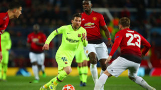 MANCHESTER, ENGLAND - APRIL 10:  Lionel Messi of FC Barcelona competes with Luke Shaw of Manchester United during the UEFA Champions League Quarter Final first leg match between Manchester United and FC Barcelona at Old Trafford on April 10, 2019 in Manchester, England. (Photo by Robbie Jay Barratt - AMA/Getty Images)