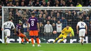 LONDON, ENGLAND - APRIL 09: Hugo Lloris of Tottenham Hotspur saves a penalty from Sergio Aguero of Manchester City during the UEFA Champions League Quarter Final first leg match between Tottenham Hotspur and Manchester City at Tottenham Hotspur Stadium on April 09, 2019 in London, England. (Photo by Dan Mullan/Getty Images)