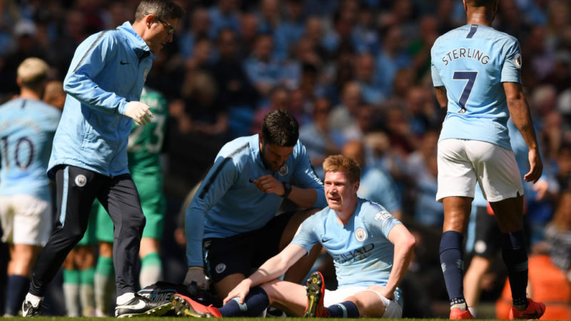 MANCHESTER, ENGLAND - APRIL 20:   Kevin De Bruyne of Manchester City receives treatment for an injury before being substituted during the Premier League match between Manchester City and Tottenham Hotspur at Etihad Stadium on April 20, 2019 in Manchester, United Kingdom. (Photo by Shaun Botterill/Getty Images)