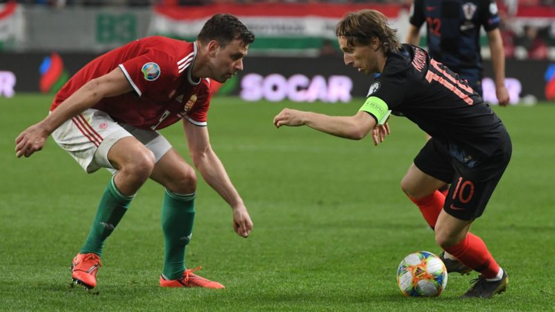 Croatia's captain and midfielder Luka Modric (R) vies with Hungary's Adam Szalai during the UEFA Euro 2020 football 1st round Groupe E qualification match between Hungary and Croatia on March 24, 2019 in Budapest. (Photo by ATTILA KISBENEDEK / AFP)
