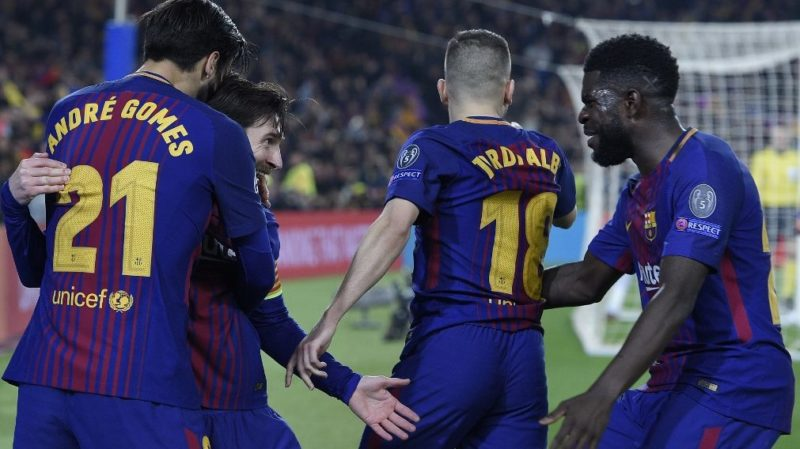 Barcelona's Argentinian forward Lionel Messi (2nd-L) celebrates with Barcelona's Portuguese midfielder Andre Gomes (L), Barcelona's French defender Samuel Umtiti (R) and Barcelona's Spanish defender Jordi Alba after scoring his team's third goal during the UEFA Champions League round of sixteen second leg football match between FC Barcelona and Chelsea FC at the Camp Nou stadium in Barcelona on March 14, 2018. (Photo by LLUIS GENE / AFP)
