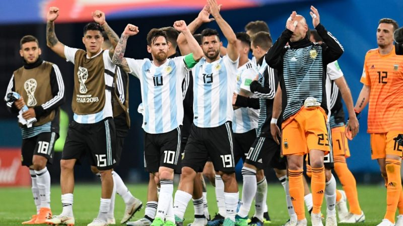 Argentina's forward Lionel Messi (C) celebrates their win and qualification during the Russia 2018 World Cup Group D football match between Nigeria and Argentina at the Saint Petersburg Stadium in Saint Petersburg on June 26, 2018. (Photo by CHRISTOPHE SIMON / AFP) / RESTRICTED TO EDITORIAL USE - NO MOBILE PUSH ALERTS/DOWNLOADS