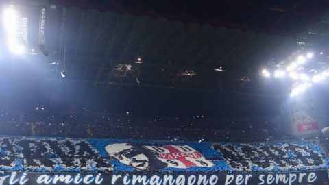 """Inter Milan fans unfurl a giant tifo reading """"Friends stay forever"""" during the Italian Serie A football match AC Milan vs Inter Milan at the San Siro stadium in Milan on March 17, 2019. (Photo by Miguel MEDINA / AFP)"""