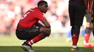 Manchester United's French midfielder Paul Pogba reacts to their defeat on the pitch after  the English Premier League football match between Manchester United and Cardiff City at Old Trafford in Manchester, north west England, on May 12, 2019. - Cardiff won the game 2-0. (Photo by Oli SCARFF / AFP) / RESTRICTED TO EDITORIAL USE. No use with unauthorized audio, video, data, fixture lists, club/league logos or 'live' services. Online in-match use limited to 120 images. An additional 40 images may be used in extra time. No video emulation. Social media in-match use limited to 120 images. An additional 40 images may be used in extra time. No use in betting publications, games or single club/league/player publications. /