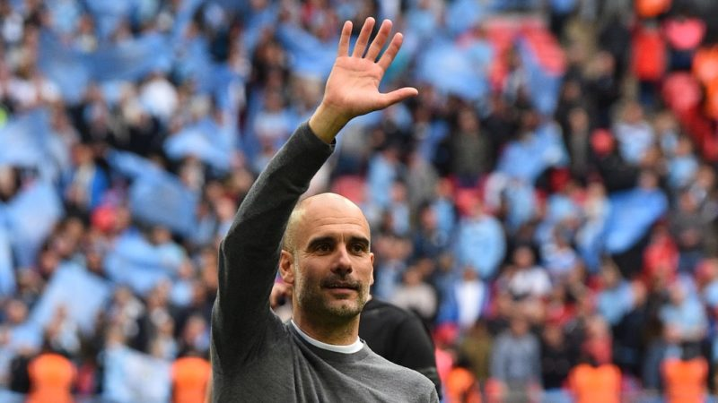 Manchester City's Spanish manager Pep Guardiola gestures as the players celebrate victory after the English FA Cup final football match between Manchester City and Watford at Wembley Stadium in London, on May 18, 2019. - Manchester City beat Watford 6-0 at Wembley to claim the FA Cup. (Photo by Glyn KIRK / AFP) / NOT FOR MARKETING OR ADVERTISING USE / RESTRICTED TO EDITORIAL USE