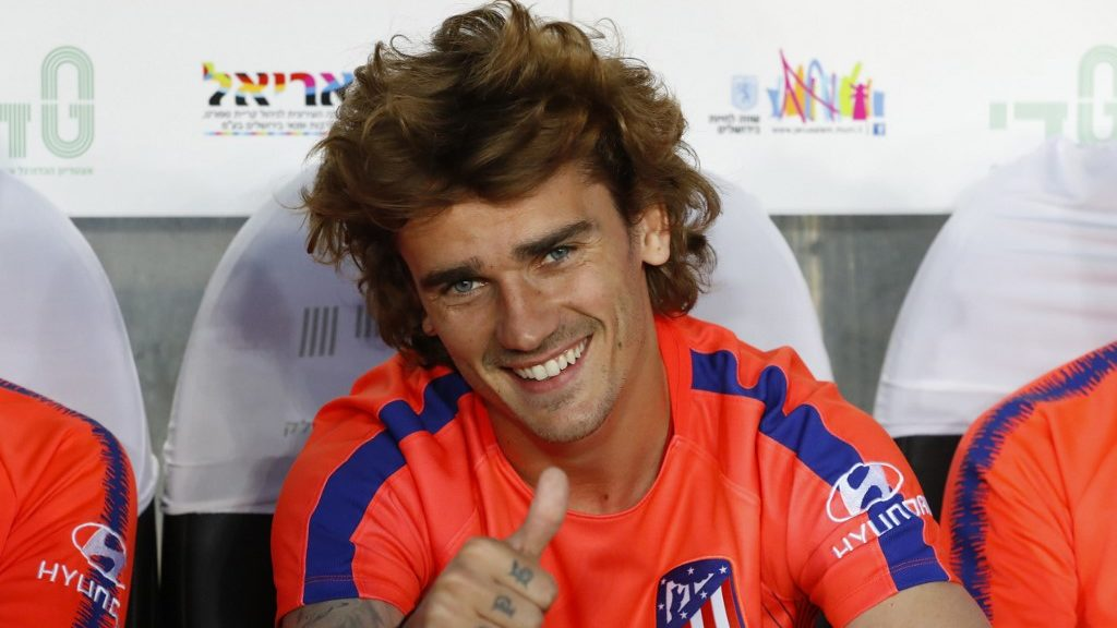 Atletico Madrid's French forward Antoine Griezmann gestures as he sits on the bench during the friendly football match between Beitar Jerusalem and Atletico Madrid at the Teddy Stadium in Jerusalem on May 21, 2019. (Photo by Jack GUEZ / AFP)