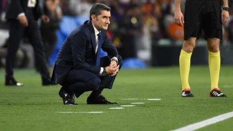 Barcelona's Spanish coach Ernesto Valverde crouches on the sideline during the 2019 Spanish Copa del Rey (King's Cup) final football match between Barcelona and Valencia on May 25, 2019 at the Benito Villamarin stadium in Sevilla. (Photo by JOSE JORDAN / AFP)