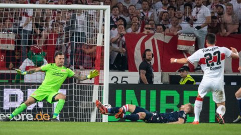 23 May 2019, Baden-Wuerttemberg, Stuttgart: Soccer: Bundesliga - Relegation, VfB Stuttgart - 1st FC Union Berlin, Relegation, first leg in the Mercedes-Benz Arena. Stuttgart's Mario Gomez (r) scores the goal to 2-1 against Berlin's goalkeeper Rafal Gikiewicz (l). Photo: Sebastian Gollnow/dpa - IMPORTANT NOTE: In accordance with the requirements of the DFL Deutsche Fußball Liga or the DFB Deutscher Fußball-Bund, it is prohibited to use or have used photographs taken in the stadium and/or the match in the form of sequence images and/or video-like photo sequences.