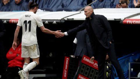MADRID, SPAIN - APRIL 6: Head Coach of Real Madrid Zinedine Zidane (R) congratulates his player Gareth Bale (11) during La Liga match between Real Madrid and Eibar at Santiago Bernabeu in Madrid, Spain on April 6, 2019. Burak Akbulut / Anadolu Agency