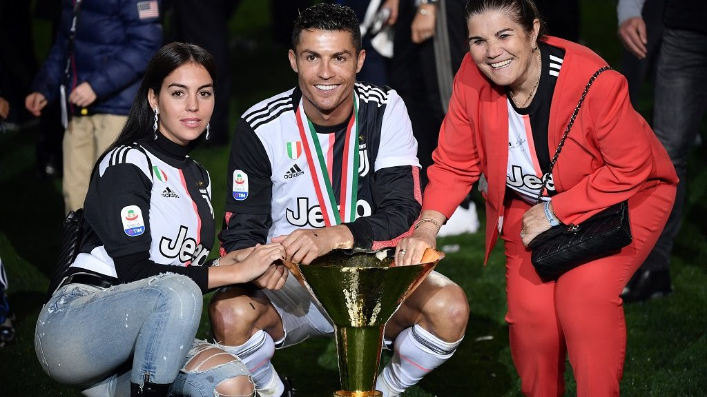 Juventus' Portuguese forward Cristiano Ronaldo (C) and his girlfriend Georgina Ronaldo and his mother pose as they celebrate Juventus being crowned champion at the end of the Italian Serie A football match Juventus vs Atalanta on May 19, 2019 at the Allianz stadium in Turin. (Photo by Marco Bertorello / AFP)