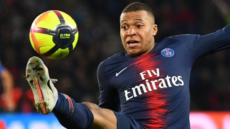 Paris Saint-Germain's French forward Kylian Mbappe controls the ball during the French L1 football match between Paris Saint-Germain (PSG) and Dijon at the Parc des Princes stadium in Paris on May 18, 2019. (Photo by FRANCK FIFE / AFP)