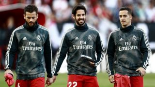 (L-R) Real Madrid's Spanish defender Nacho Fernandez, Real Madrid's Spanish midfielder Isco and Real Madrid's Spanish midfielder Lucas Vazquez walk on the pitch ahead of the Spanish League football match between Rayo Vallecano and Real Madrid at the Vallecas Stadium in the Madrid district of Puente de Vallecas on April 28, 2019. (Photo by BENJAMIN CREMEL / AFP)