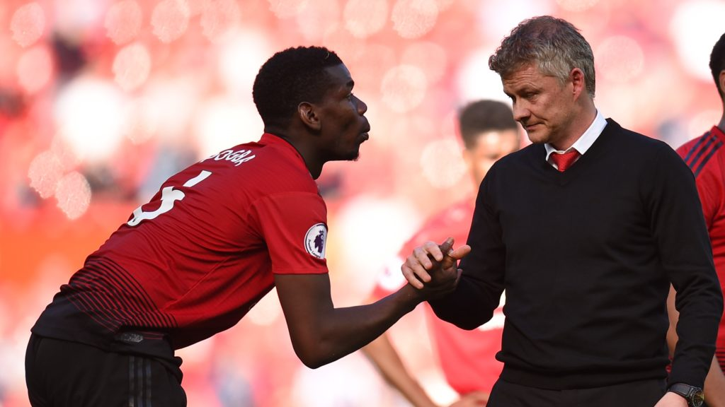 Manchester United's French midfielder Paul Pogba (L) shakes hands with Manchester United's Norwegian manager Ole Gunnar Solskjaer (R) on the pitch after  the English Premier League football match between Manchester United and Cardiff City at Old Trafford in Manchester, north west England, on May 12, 2019. - Cardiff won the game 2-0. (Photo by Oli SCARFF / AFP) / RESTRICTED TO EDITORIAL USE. No use with unauthorized audio, video, data, fixture lists, club/league logos or 'live' services. Online in-match use limited to 120 images. An additional 40 images may be used in extra time. No video emulation. Social media in-match use limited to 120 images. An additional 40 images may be used in extra time. No use in betting publications, games or single club/league/player publications. /