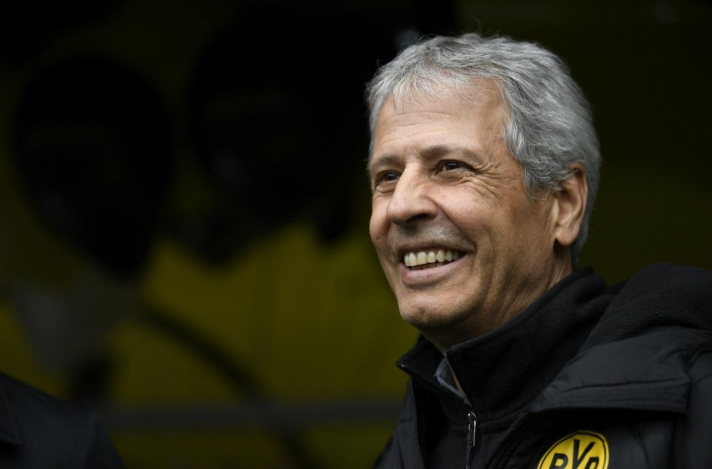 (FILES) In this file photo taken on May 11, 2019 Dortmund's Swiss coach Lucien Favre smiles prior to the German first division Bundesliga football match Borussia Dortmund vs Fortuna Duesseldorf in Dortmund, western Germany. - Borussia Dortmund coach Lucien Favre has extended his contract until the end of 2020/21, the Bundesliga club confirmed on June 18, 2019. Favre, 61, took the reins at Dortmund at the beginning of last season and led the club to a second-place Bundesliga finish behind perennial title winners Bayern Munich in his first year in charge. (Photo by INA FASSBENDER / AFP) / RESTRICTIONS: DFL REGULATIONS PROHIBIT ANY USE OF PHOTOGRAPHS AS IMAGE SEQUENCES AND/OR QUASI-VIDEO