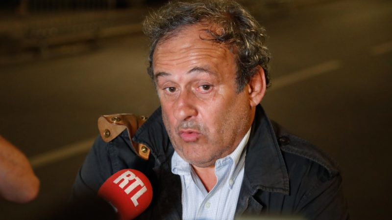 """Ex-UEFA chief Michel Platini talks to the media before leaving the Central Office for Combating Corruption and Financial and Tax Crimes after being arrested in connection with a criminal investigation into the award of the 2022 World Cup to Qatar, in Nanterre, west of Paris in the early hours of June 19, 2019. - The banned ex-UEFA chief Michel Platini was freed from French custody Wednesday, an AFP journalist said, after several hours of questioning in connection with a criminal investigation into the awarding of the 2022 World Cup to Qatar. """"He is no longer in custody,"""" William Bourdon, the lawyer of the French football legend, said shortly before 1:00 am. There had been """"a lot of fuss over nothing"""", he added. (Photo by Zakaria ABDELKAFI / AFP)"""