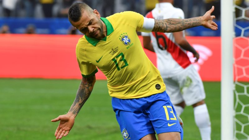 Brazil's Dani Alves celebrates after scoring against Peru during their Copa America football tournament group match at the Corinthians Arena in Sao Paulo, Brazil, on June 22, 2019. (Photo by Nelson ALMEIDA / AFP)