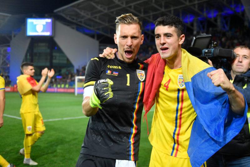 Romania's Ionut Radu and Alexandru Pascanu celebrate after the game (Photo by Alex Nicodim/NurPhoto via Getty Images)