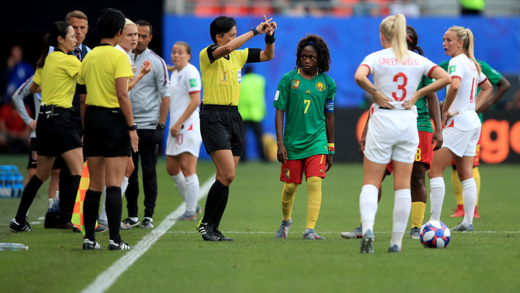 VALENCIENNES, FRANCE - JUNE 23: Gabrielle Onguene of Cameroon  looks on after Referee Liang Qin makes a VAR decision during the 2019 FIFA Women's World Cup France Round Of 16 match between England and Cameroon at Stade du Hainaut on June 23, 2019 in Valenciennes, France. (Photo by Marc Atkins/Getty Images)