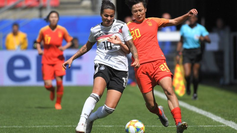 (FILES) In this file photo taken on June 8, 2019, Germany's midfielder Dzsenifer Marozsan (L) vies for the ball with China's midfielder Rui Zhang during the France 2019 Women's World Cup Group B football match between Germany and China at the Roazhon Park stadium in Rennes, western France. - Germany and Olympique Lyon star Dzsenifer Marozsan is set to make a return to World Cup action in the last-eight clash with Sweden on June 29, 2019 after missing three games with a broken toe, coach Martina Voss-Tecklenburg said on June 25, 2019. (Photo by LOIC VENANCE / AFP)