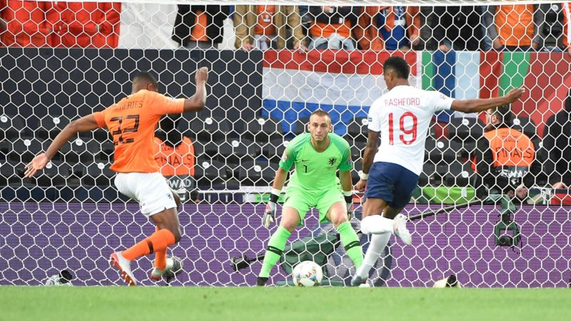 England's forward Marcus Rashford (R) controls the ball just before scoring past Netherlands' goalkeeper Jasper Cillessen and Netherlands' defender Denzel Dumfries during the UEFA Nations League semi-final football match between The Netherlands and England at the Afonso Henriques Stadium in Guimaraes on June 6, 2019. (Photo by MIGUEL RIOPA / AFP)