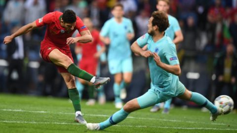 Portugal's forward Goncalo Guedes (L) shoots to score the opening goal with Portugal's forward Bernardo Silva during the UEFA Nations League final football match between Portugal and The Netherlands at the Dragao Stadium in Porto on June 9, 2019. (Photo by PATRICIA DE MELO MOREIRA / AFP)