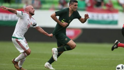Hungary's Jozsef Varga (L) vies for the ball with Australia's Tom Rogic during the international friendly footbal match Hungary vs Australia in Budapest, on June 9, 2018. (Photo by FERENC ISZA / AFP)