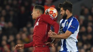 Liverpool's Brazilian midfielder Roberto Firmino (L) vies with Porto's Brazilian defender Felipe (R) during the UEFA Champions League quarter-final, first leg football match between Liverpool and FC Porto at Anfield stadium in Liverpool, north-west England on April 9, 2019. (Photo by Paul ELLIS / AFP)