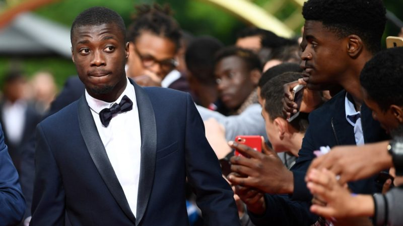 Lille forward Nicolas Pepe arrives to take part in a TV show on May 19, 2019 in Paris, as part of the 28th edition of the UNFP (French National Professional Football players Union) trophy ceremony. (Photo by FRANCK FIFE / AFP)