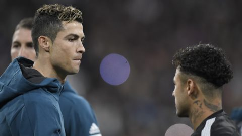 Real Madrid's Portuguese forward Cristiano Ronaldo (L) shakes hands with Paris Saint-Germain's Brazilian forward Neymar (R) before the UEFA Champions League round of sixteen first leg football match Real Madrid CF against Paris Saint-Germain (PSG) at the Santiago Bernabeu stadium in Madrid on February 14, 2018. (Photo by GABRIEL BOUYS / AFP)