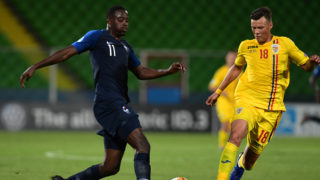 France's forward Jean-Philippe Mateta (L) and Romania's defender Adrian Rus go for the ball during the Group C match of the U21 European Football Championships between France and Romania on June 24, 2019 at the Dino-Manuzzi stadium in Cesena. (Photo by Miguel MEDINA / AFP)