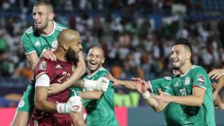 11 July 2019, Egypt, Suez: Algeria players celebrate after the final whistle of the 2019 Africa Cup of Nations quarter final soccer match between Cote d'Ivoire and Algeria at the Suez Sports Stadium. Photo: Oliver Weiken/dpa