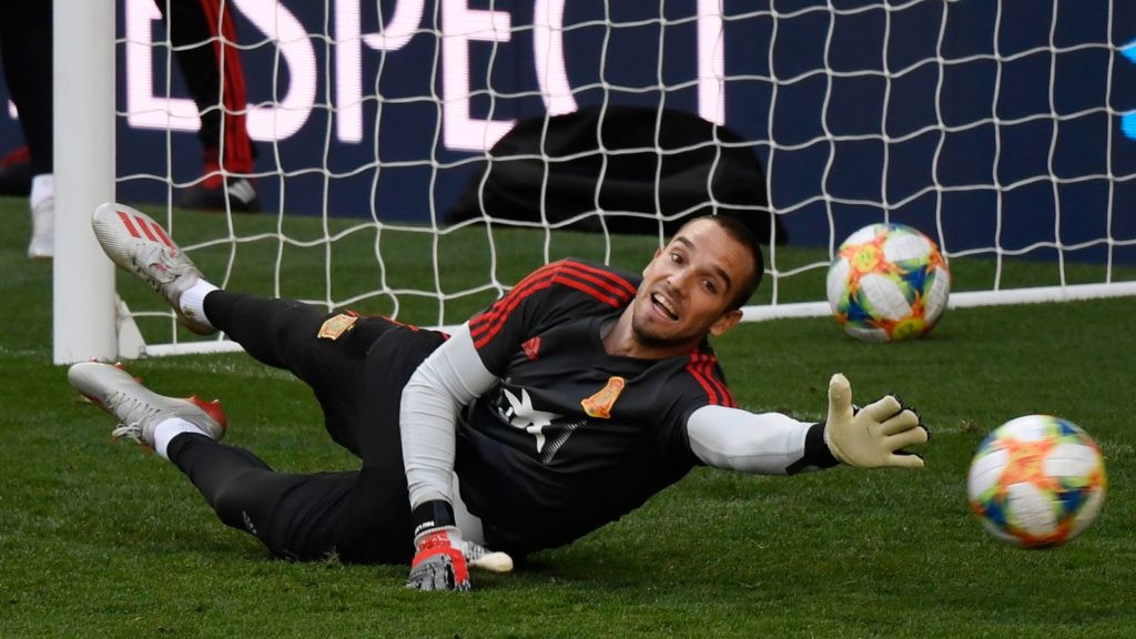 (FILES) In this file photo taken on June 09, 2019 Spain's goalkeeper Pau Lopez attends a training session at the Santiago Bernabeu stadium in Madrid on the eve of the UEFA Euro 2020 group F qualifying football match between Spain and Sweden. - Spain international goalkeeper Pau Lopez has completed his move from Real Betis to Serie A giants Roma, the two clubs announced late on July 10, 2019. The 24-year-old has signed a five-year deal with Roma paying 23.5 million euros ($26.48 million). (Photo by PIERRE-PHILIPPE MARCOU / AFP)