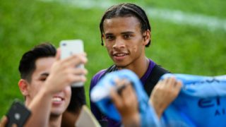 English Premier League Manchester City player Leroy Sane (C) takes a selfie with a fan after a team training session in Hong Kong on July 23, 2019, a day before their match against local team Kitchee. (Photo by ANTHONY WALLACE / AFP)