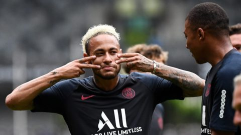 Paris Saint-Germain's Brazilian forward Neymar (L) jokes with Saint-Germain's French forward Kylian MBappe (R) during a training session at the Shenzhen Universiade Stadium in Shenzhen on August 2, 2019, on the eve of the French Trophy of Champions football match between Rennes and Paris Saint-Germain. (Photo by FRANCK FIFE / AFP)